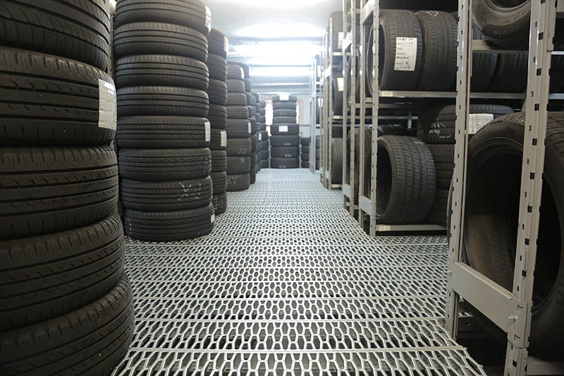 part worn tyres stacked up in racking
